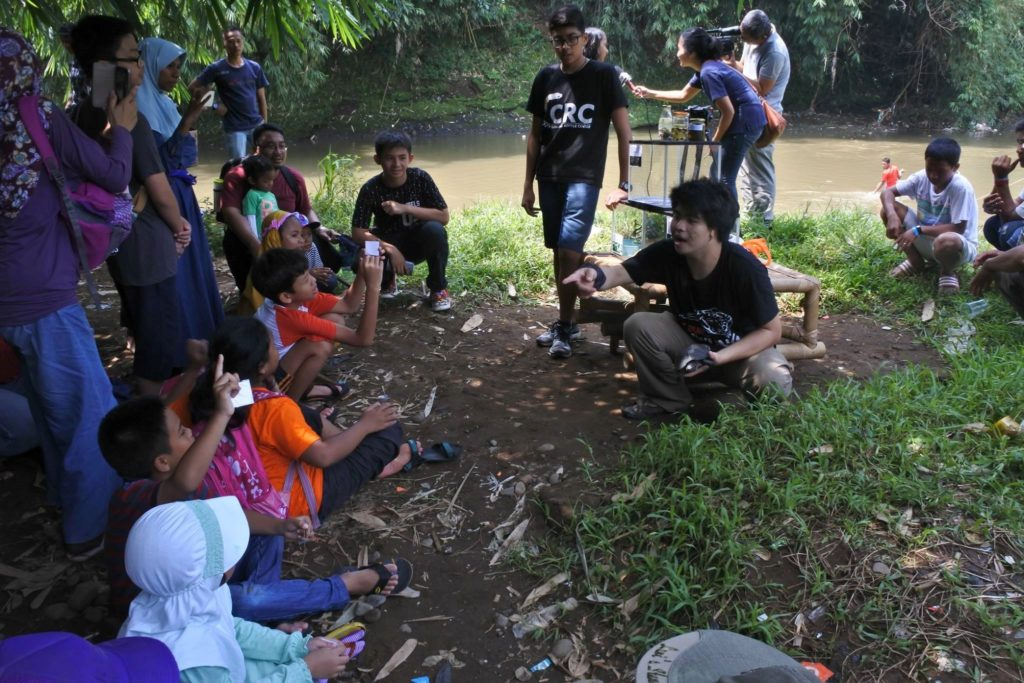 Education to local children by the Ciliwung river